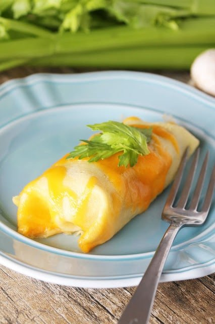 Chicken, vegetables, and cheddar cheese are stuffed into this savory crepe recipe.