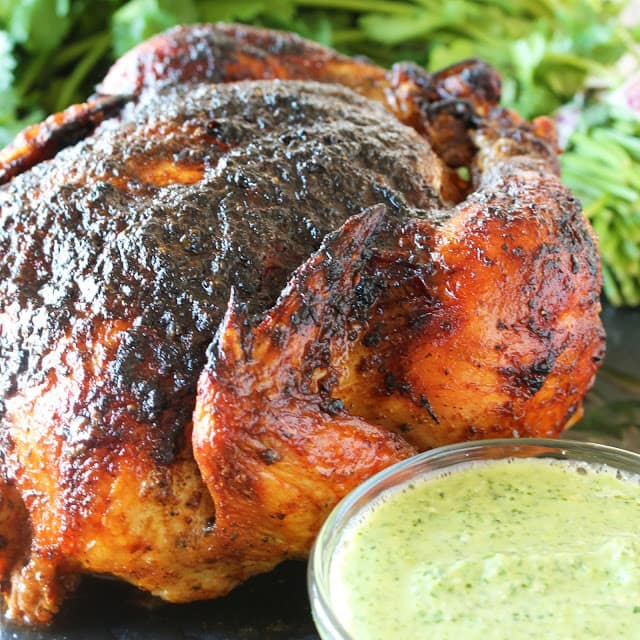 Peruvian-spiced chicken, roasted whole in the oven, and served with the most incredible green dipping sauce.