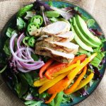 This Mojo Grilled Chicken Salad is a healthy dinner that is full of flavor. Chicken is marinated in a Cuban mojo (citrus-garlic sauce) and grilled to perfection. Served up in a delicious salad with sliced avocado, grilled bell peppers, pickled red onion, and jalapeno.