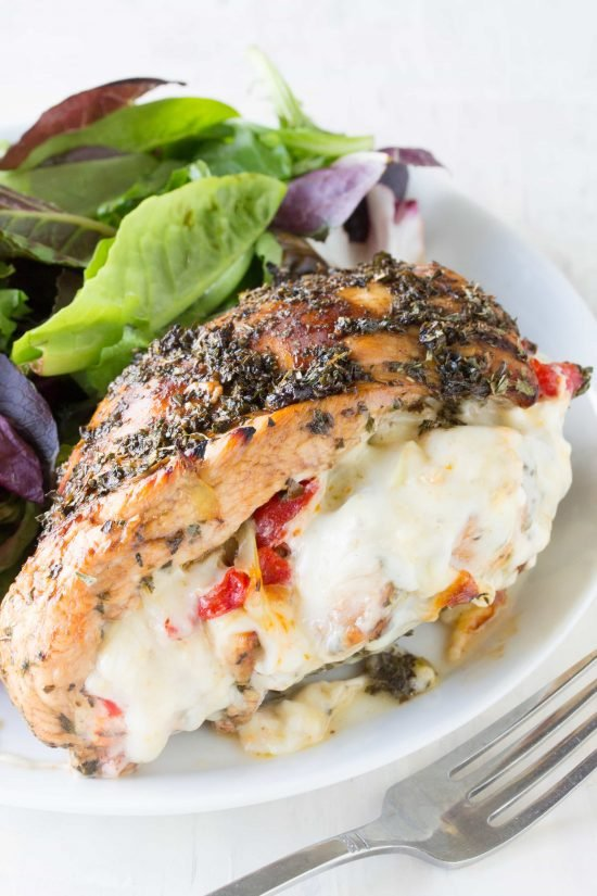 Balsamic and herb glazed chicken, stuffed with artichoke, bell pepper, and fennel. This Italian Stuffed Chicken will tickle your tastebuds!