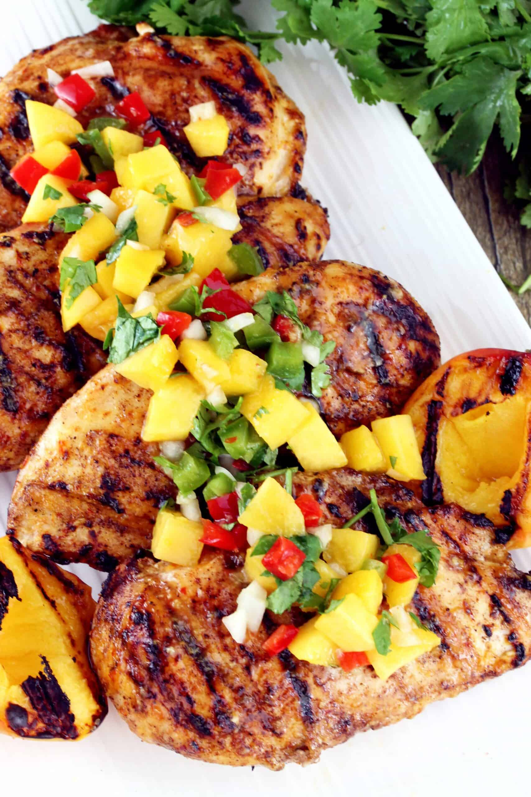 Bird's eye view of grilled chicken topped with a chipotle peach glaze.