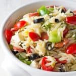 Classic Italian orzo pasta salad, complete with a homemade dressing and mini pepperonis. This traditional American pasta salad is great with an orzo pasta twist.
