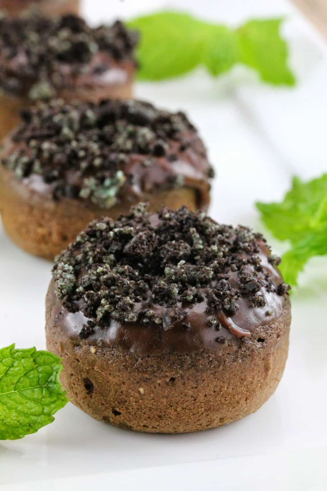 Chocolate donut with mint frosting.