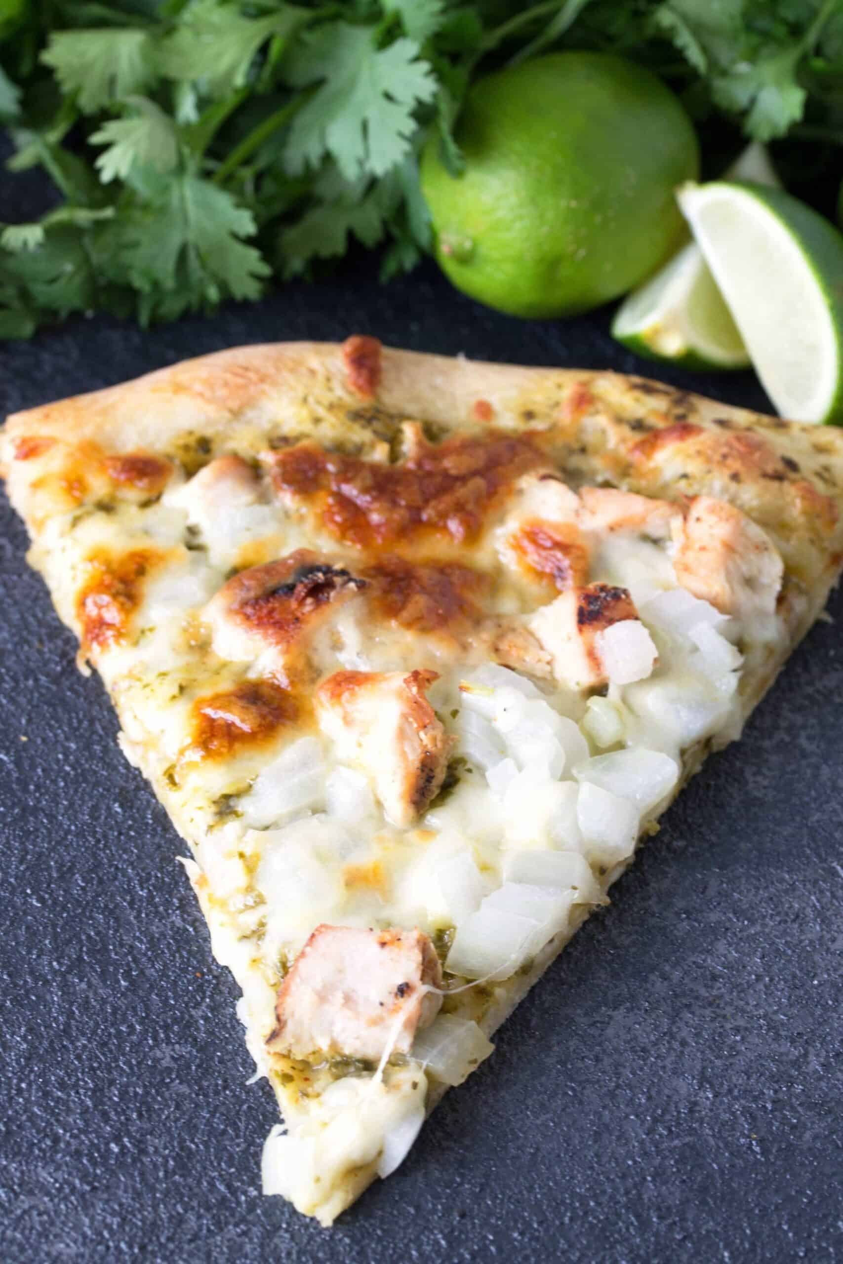 A slice of Cilantro Lime Chicken Pizza.
