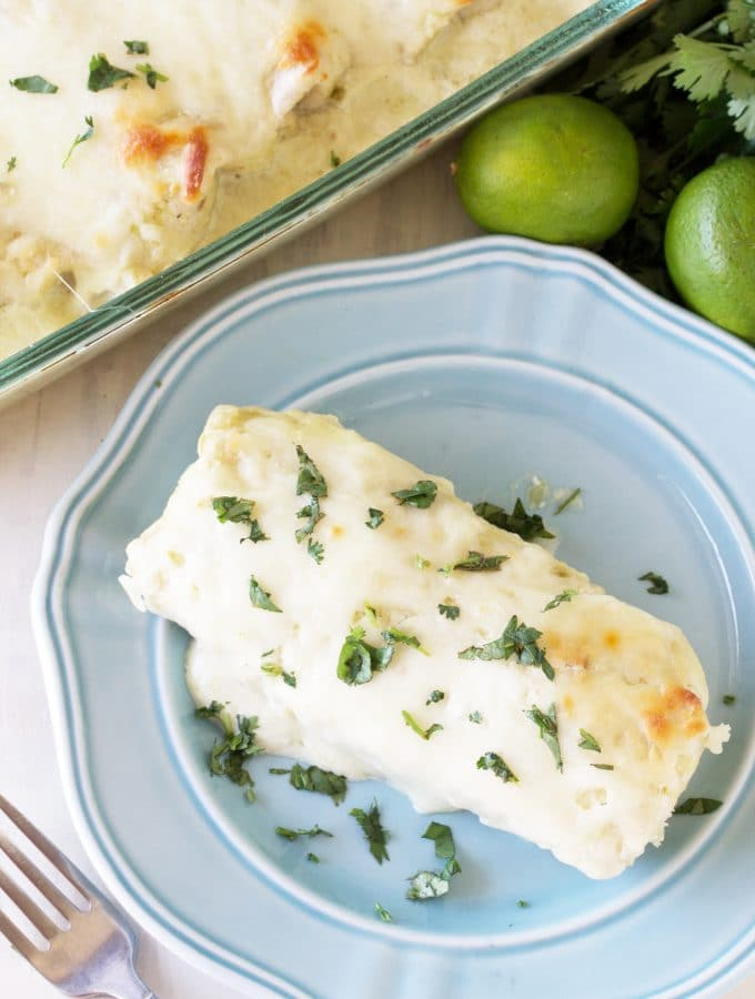These easy to put together Green Chile Cream Cheese Enchiladas are a classic American family favorite. This version is quick to put together using fresh ingredients.