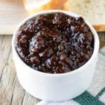 Bacon jam in a white bowl.