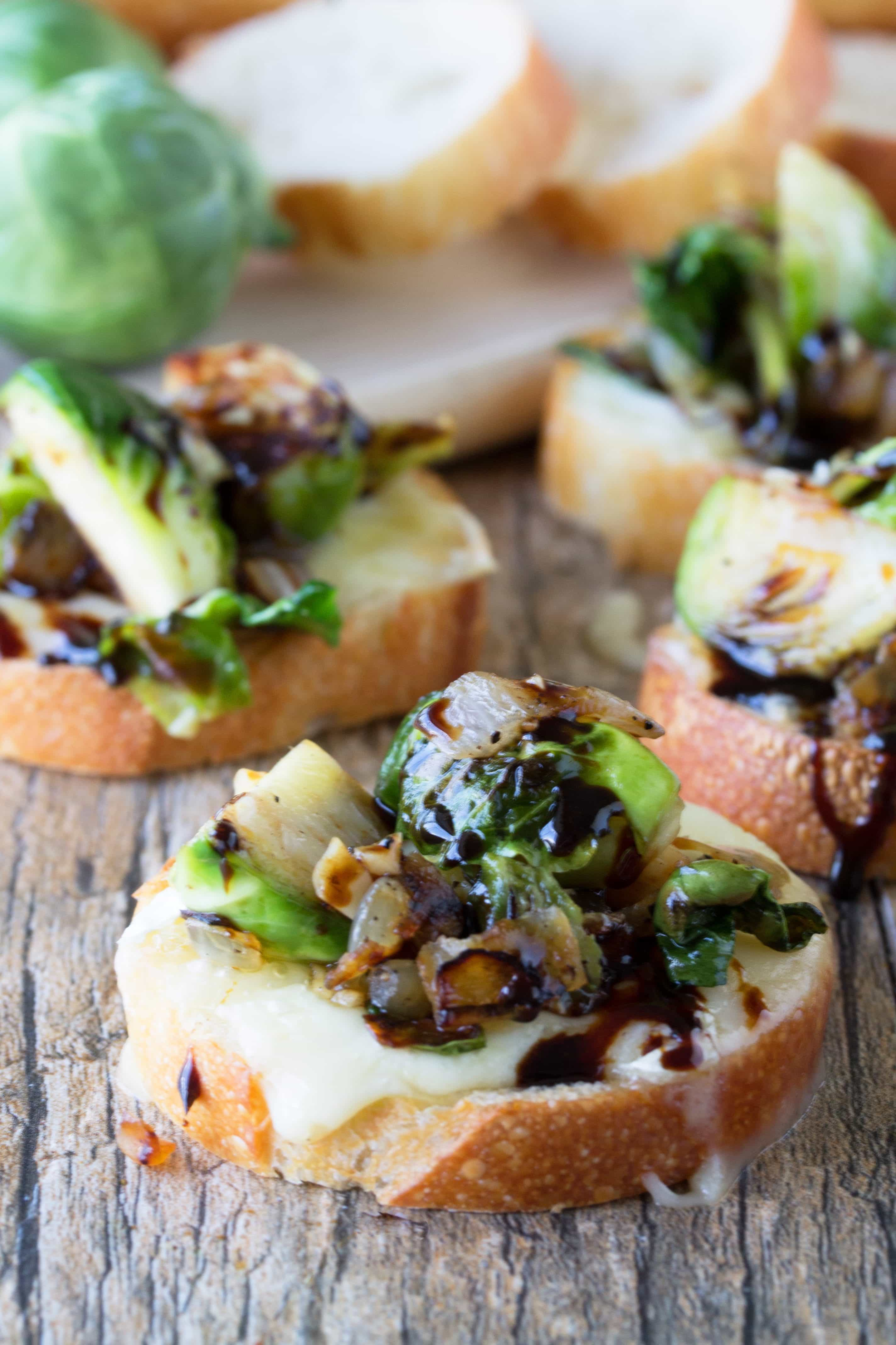 Brussel Sprout and Brie Bruschetta is a trendy appetizer that is both beautiful and tasty. Drizzle it in some fine balsamic vinegar and you have a total winner!