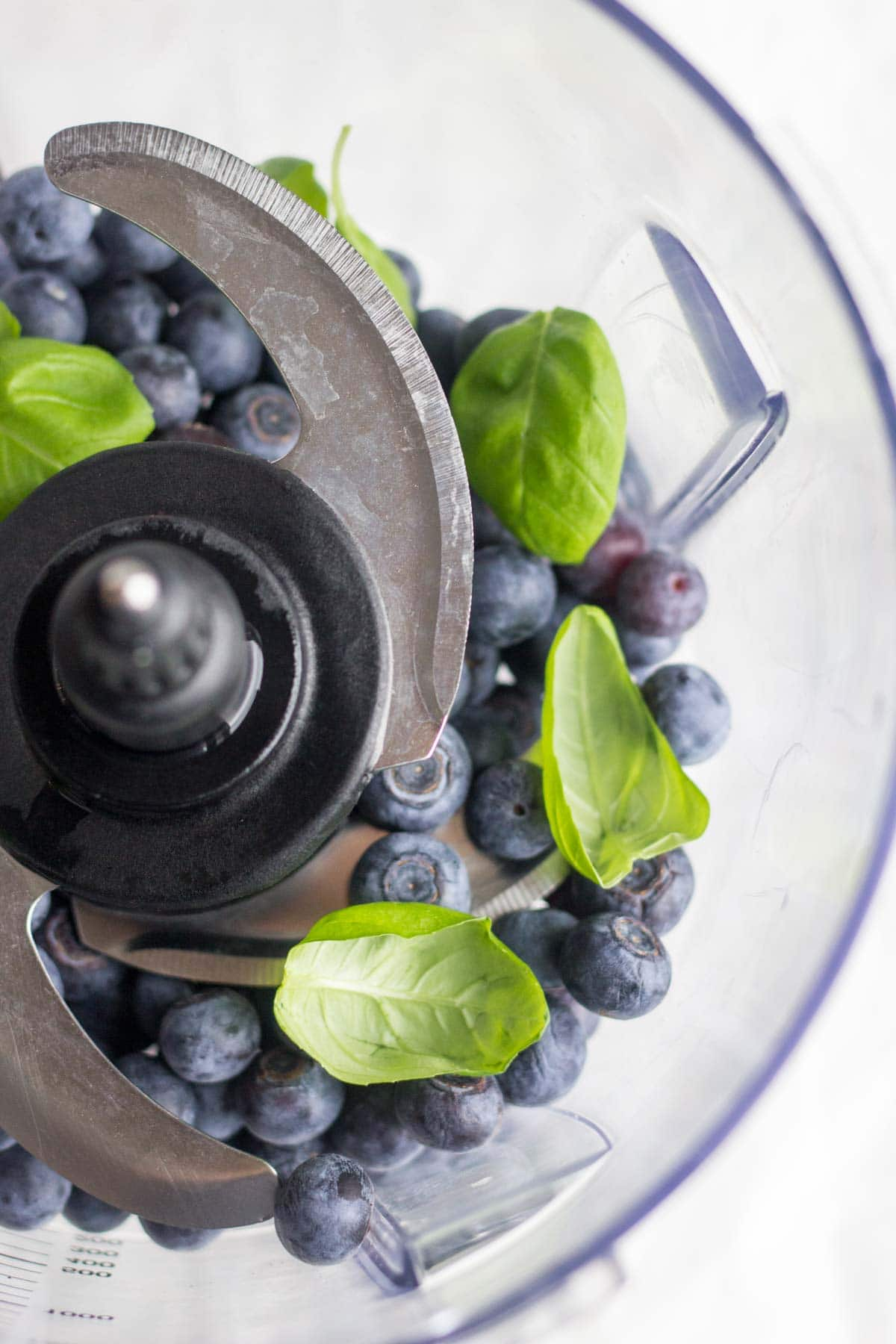 Healthy, 3-ingredient blueberry basil popsicles are the perfect easy and healthy treat! They take less than 15 minutes to make and freeze in a couple hours. Your family and friends will be amazed that they're made with whole foods and taste so delicious and sweet!