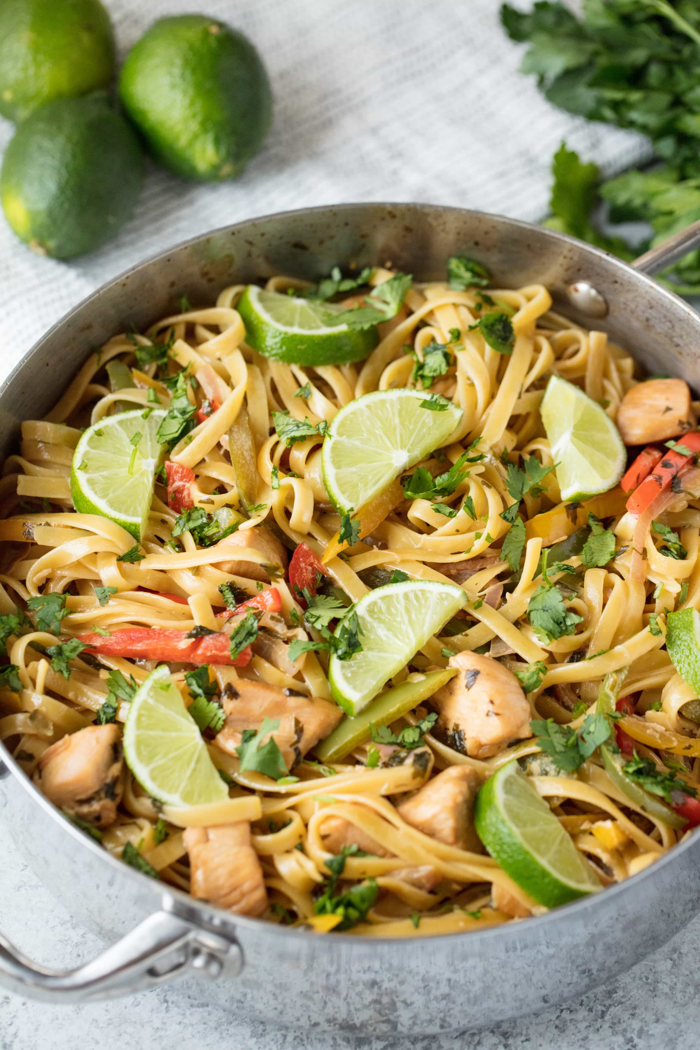Tequila Lime Chicken Pasta is fun, vibrant, and full of flavor. This easy weeknight dinner is a complete meal with meat, veggies, and pasta all in one amazing dish. And the tequila burns off so it's family friendly too!
