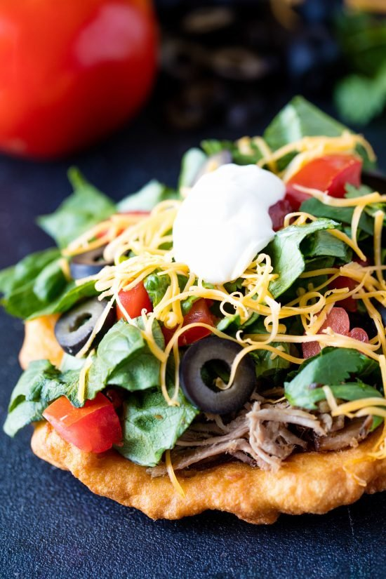 Authentic Indian fry bread topped with pulled pork, greens, diced tomatoes, cheese, olives, and sour cream