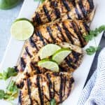Margarita Grilled Chicken is salty lime goodness that's perfect for a party! This easy grill recipe is perfect for summer parties, backyard barbecues, and cookouts and can feed a family for a weeknight meal, or easily feed a crowd.