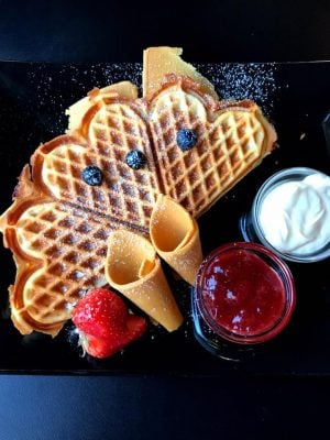 Norwegian Waffles at Nilsen Spiceri in Oslo, Norway with brown cheese, sour cream, and jam