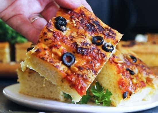 Zesty Focaccia Bread, thick, airy, flat Italian bread that can be topped with some savory ingredients to make this your new garlic bread or roll substitute. keviniscooking.com