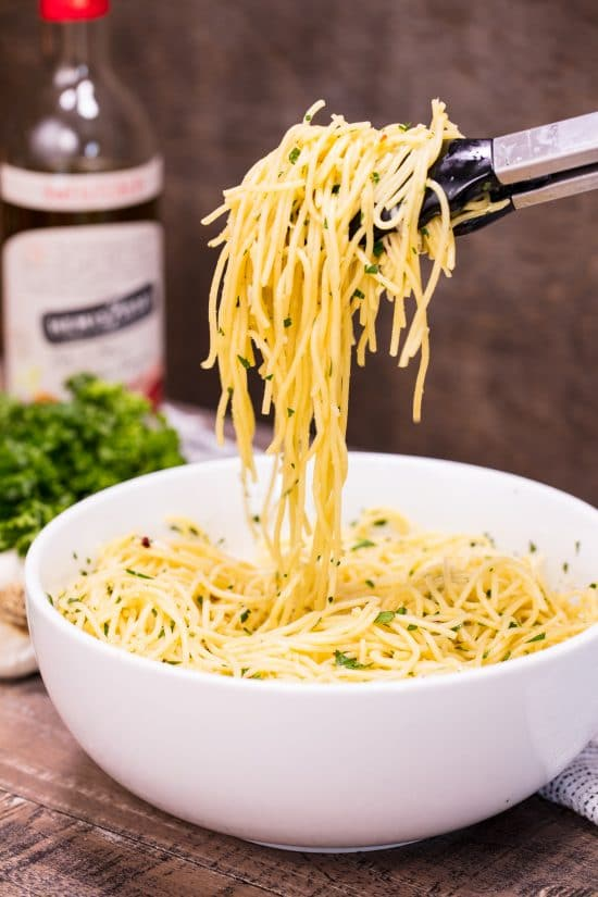 This Super Easy Olive Oil Pasta is a simple side dish that is quick to make and easily customizable to become a full meal. Just add meat and veggies!
