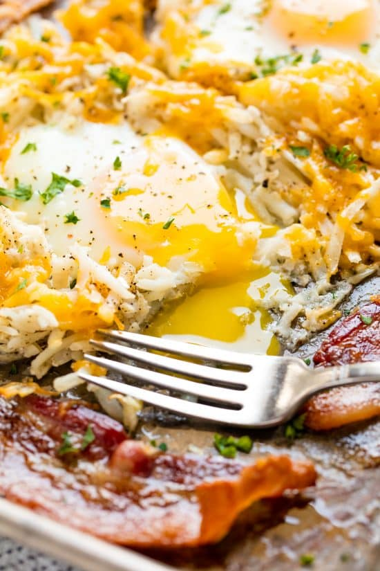 This super easy One Pan Breakfast Bake has bacon, hash browns, and eggs and takes just five minutes of hands on time to create a complete breakfast.