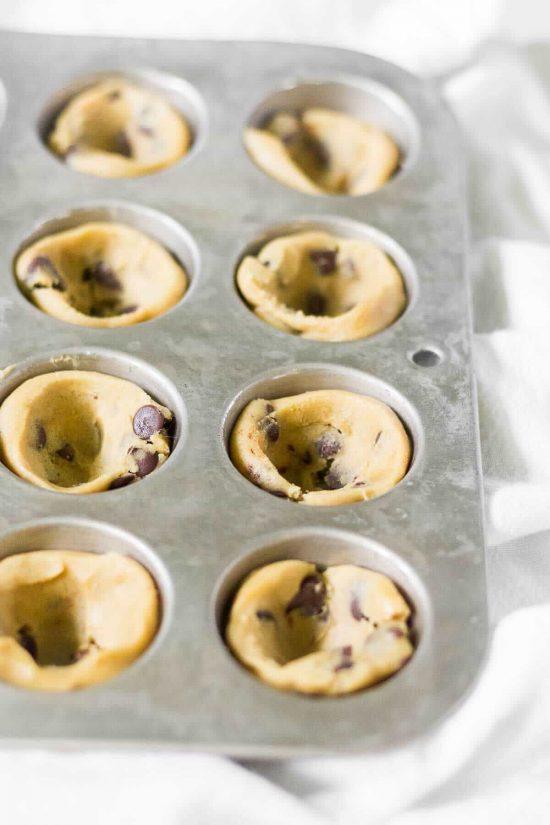 cookie dough in a mini muffin pan