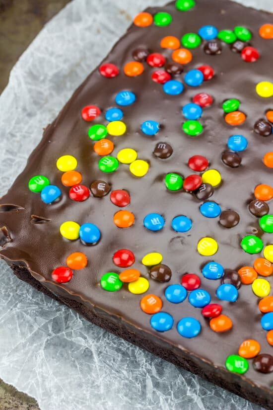 Thick, rich and delicious these M&M Fudge Brownies are overloaded with chocolate, candy and ganache making this the perfect indulgence.