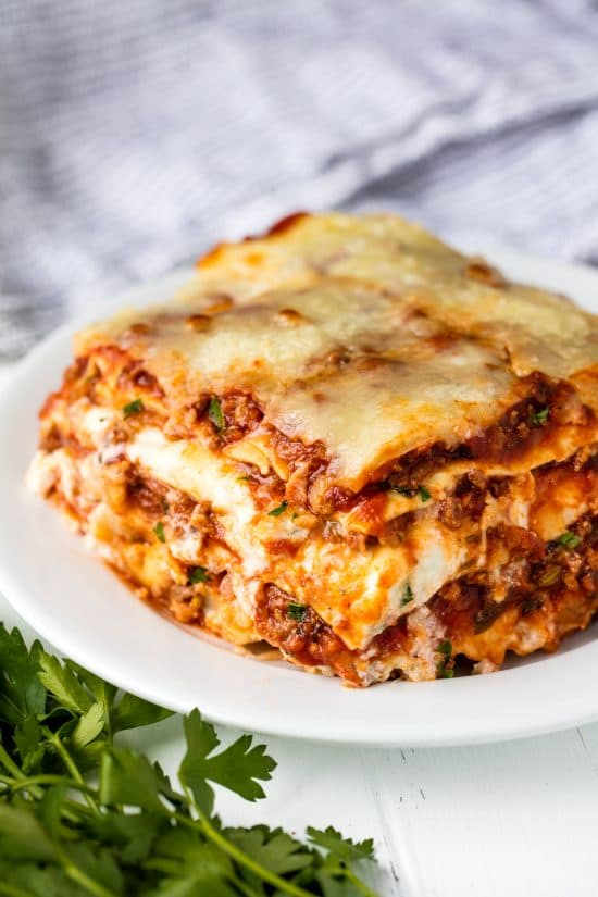 The Most Amazing Lasagna Recipe is the best recipe for homemade Italian-style lasagna. The balance between layers of cheese, noodles, and homemade bolognese sauce is perfection!