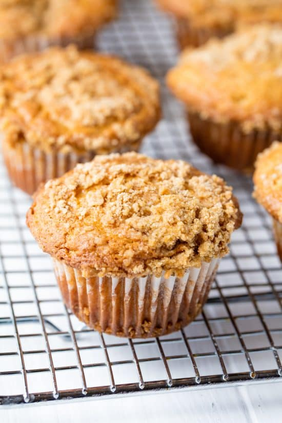 Sour Cream Coffee Cake Muffins are super moist and topped with the most delicious streusel topping. You'll love these classic muffins!