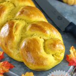braided pumpkin bread with knife to slice