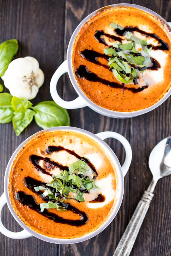 This Easy Caprese Soup is full of hearty tomato flavor and topped off with fresh mozzarella cheese and a drizzle of balsamic for the ultimate comfort food soup.