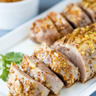 Perfectly tender Honey Dijon Garlic Roasted Pork Tenderloin only requires a few ingredients, and a few minutes of your time to get roasting in the oven. It's a flavorful, juicy pork tenderloin that your family will love!