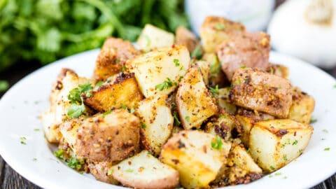 Closeup of roasted pesto potatoes on a plate