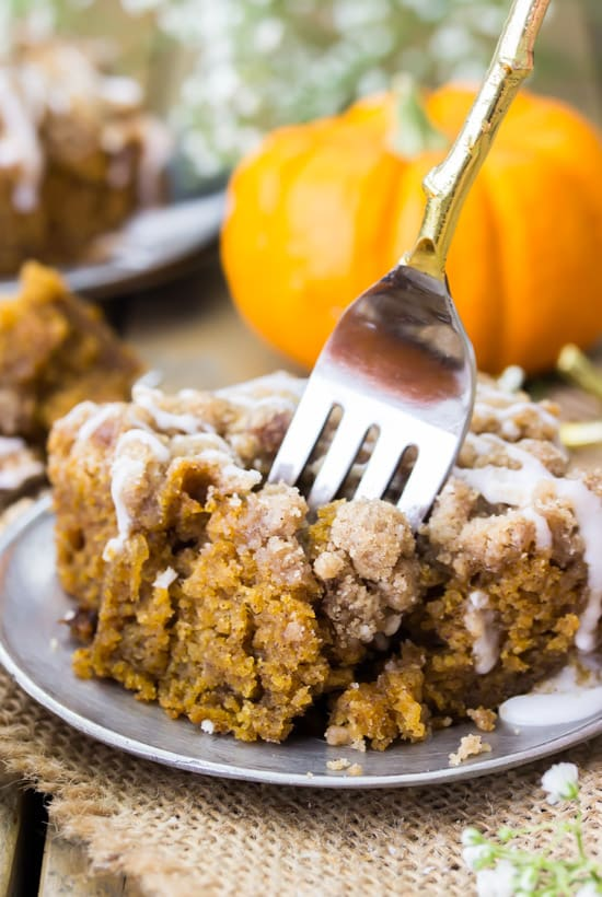This moist pumpkin crumb cake is a soft, seasonally flavored pumpkin cake infused with the best flavors of fall (think pumpkin spice, cinnamon, and real pumpkin) and topped off with a buttery cinnamon crumble topping!