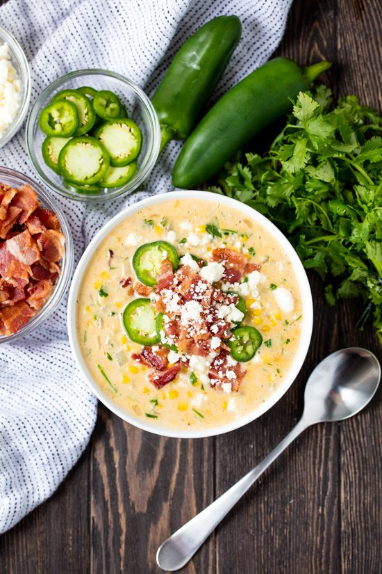 Mexican Street Corn Soup topped with sliced jalepeno, crispy bacon and cotija cheese