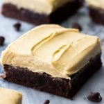 Brownies cut into squares, topped with peanut butter frosting