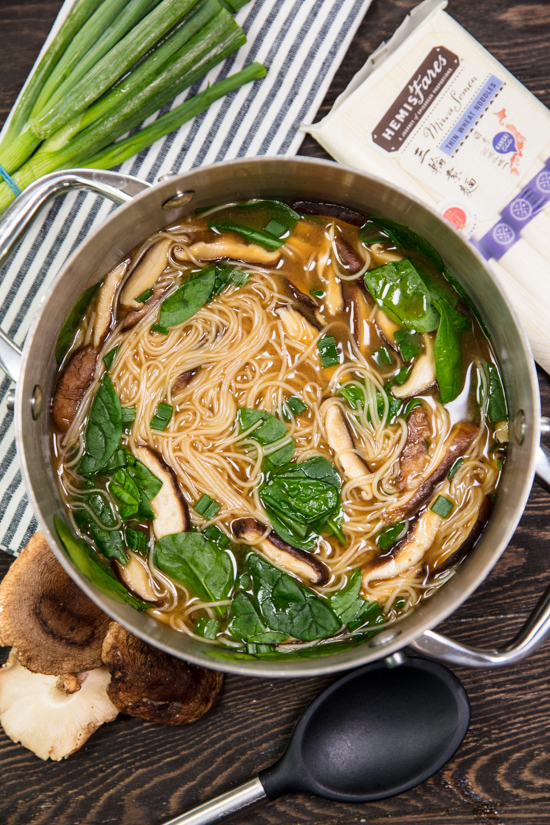A pot of Miso Noodle Soup with Miwa somen noodles, shitake mushrooms, spinach and green onion