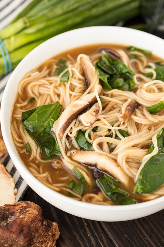 A bowl of Noodle Miso Soup with Miwa somen noodles, with shitake mushrooms, spinach and green onion
