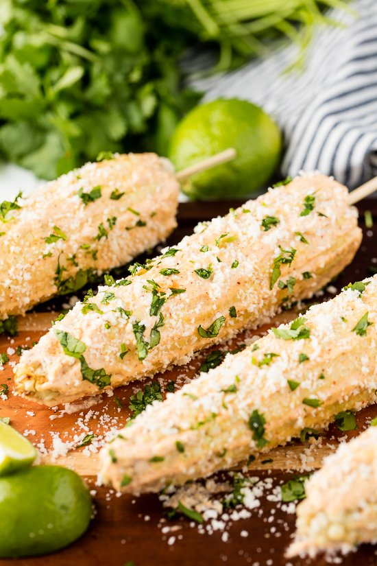Authentic Mexican Street Corn rolled in a creamy mayonnaise/crema mixture and topped with cotija cheese and cilantro