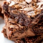 Close up of three Brownie squares stacked on each other.