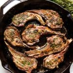 Lamb Chops in a cast-iron skillet.