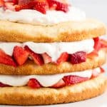 Strawberry Shortcake on a white cake stand.