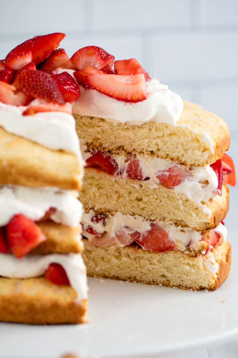 Strawberry Shortcake with a slice taken out of it.