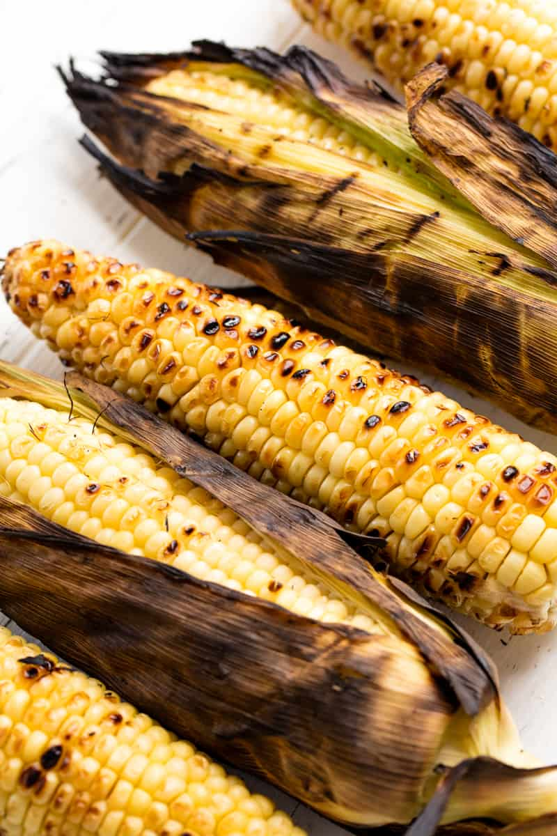 Grilled Corn on the cob on a countertop.