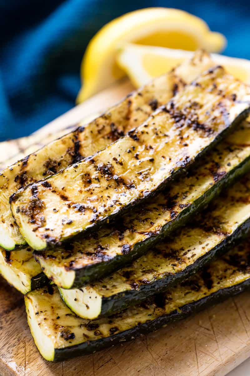 A stack of Grilled Zucchini on a cutting board.