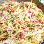 Pasta Carbonara in a stainless steel skillet.
