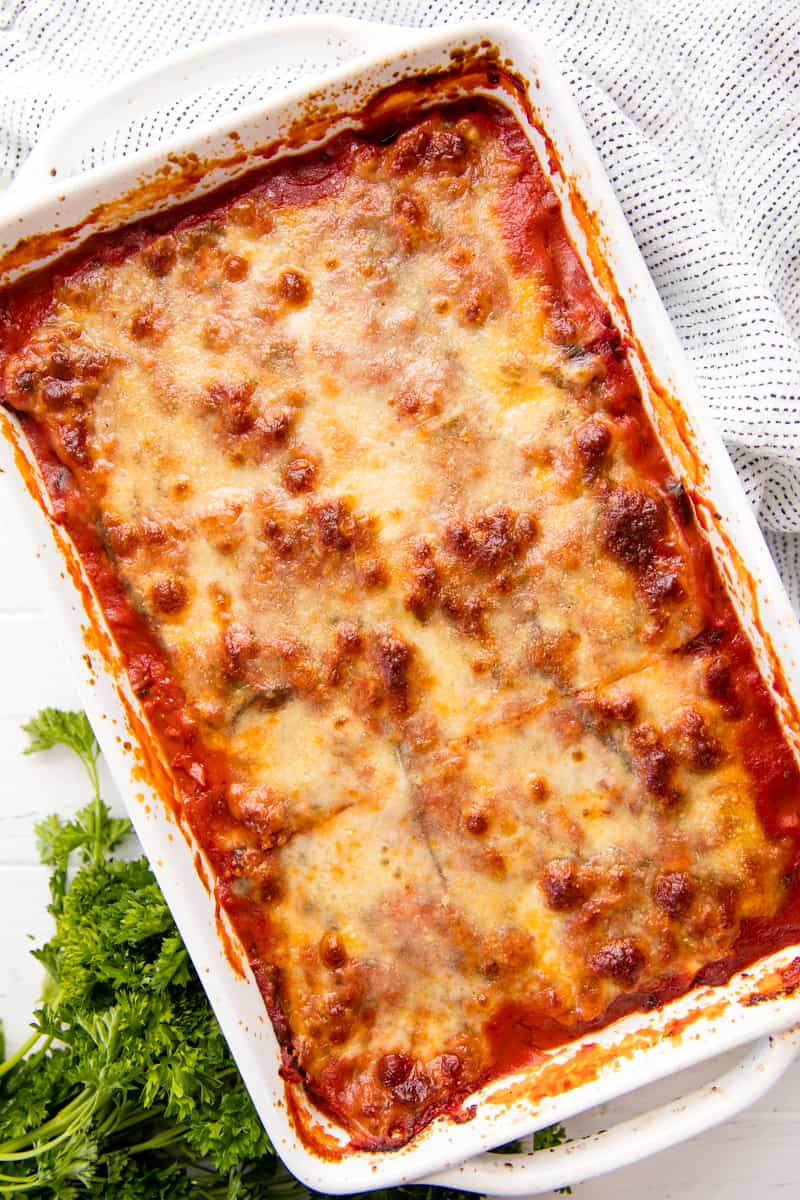 Eggplant Lasagna in a casserole dish, topped with bubbly cheese