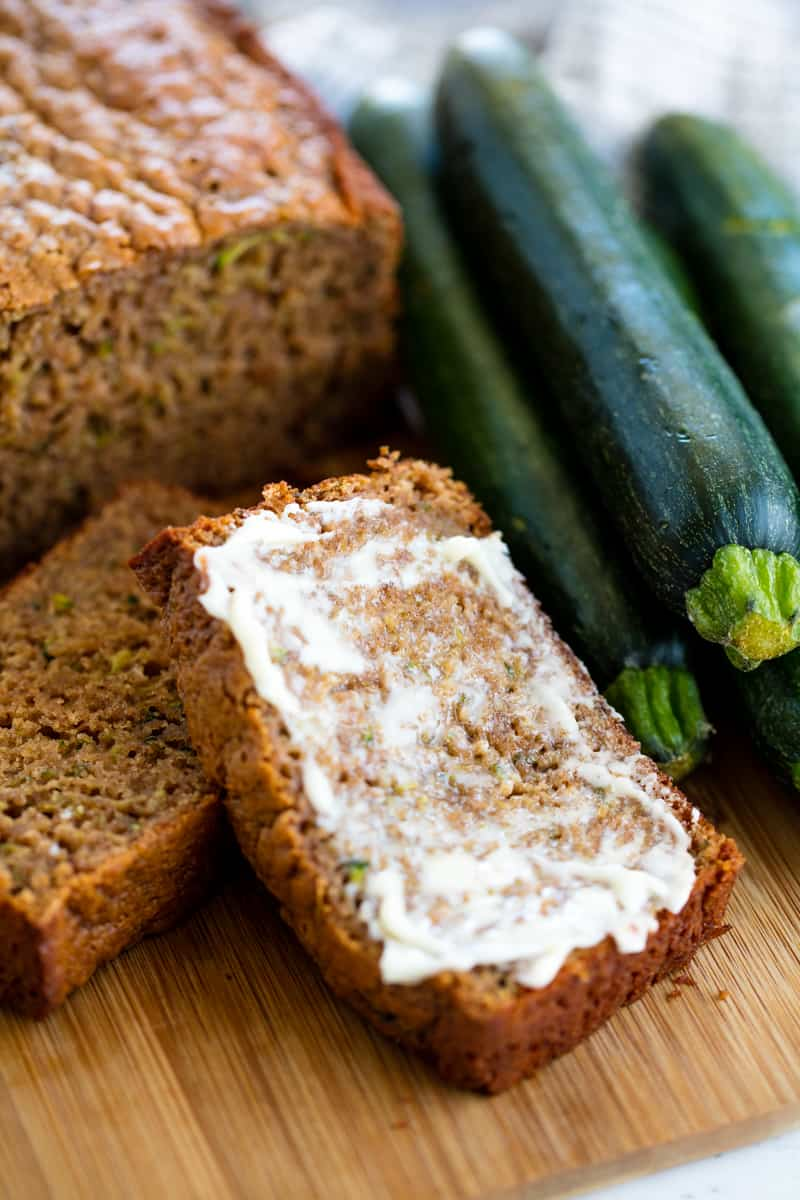 Zucchini Bread with butter spread on it.