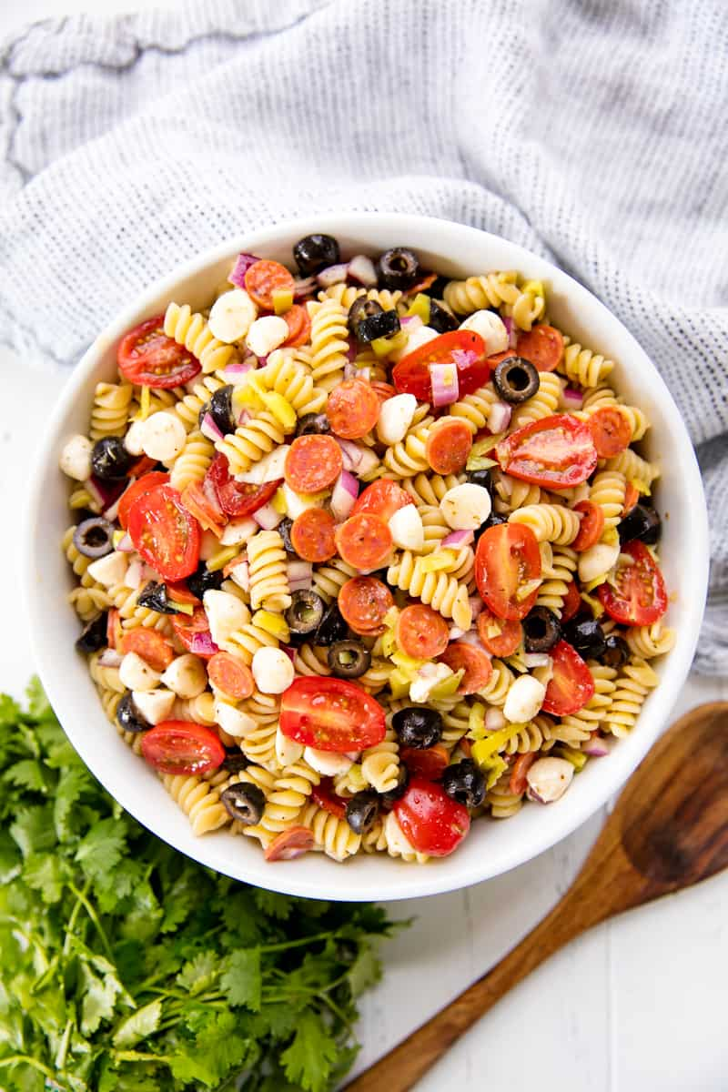 A white bowl full of Pasta Salad.