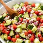 Cucumber Tomato Salad with cherry tomatoes, cucumber and red onion, tossed with lemon dill dressing in a bowl