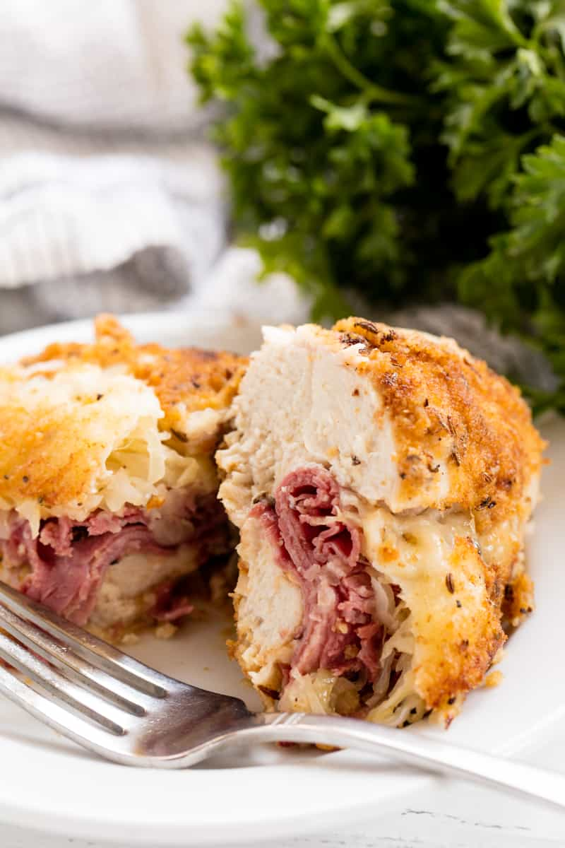 Stuffed Chicken cut in half to show the Reuben stuffing.