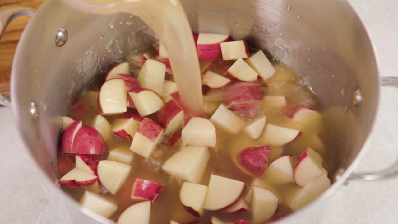 Diced potatoes in chicken broth