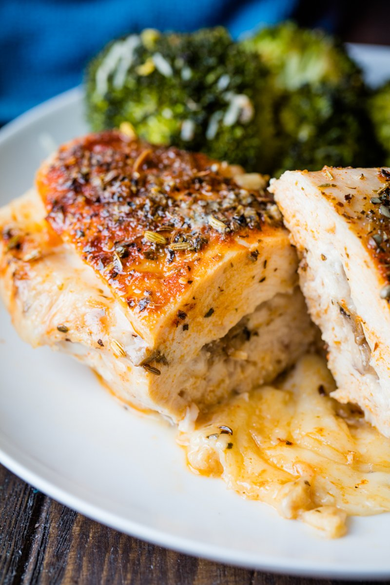 herb stuffed chicken breast on a plate.