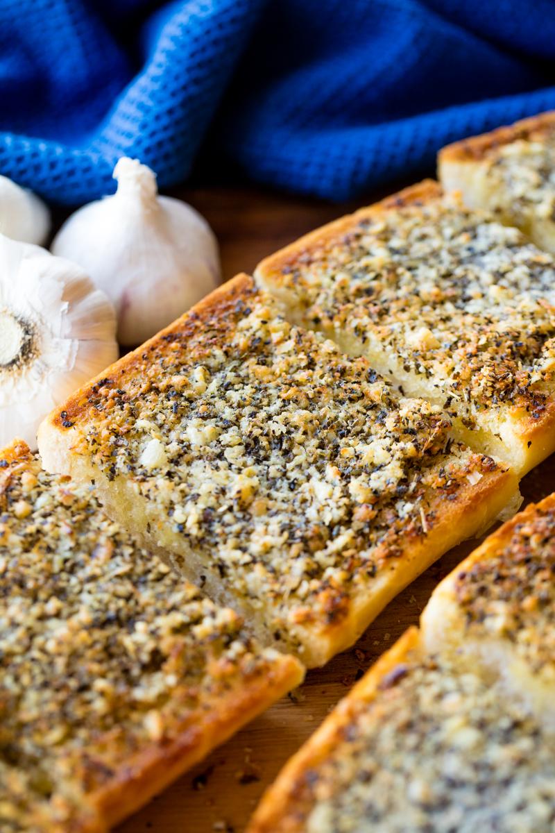 A loaf of garlic bread cut into slices.