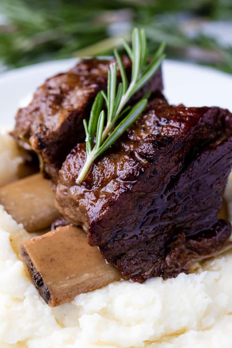 Close up of Beef Short Ribs on mashed potatoes.
