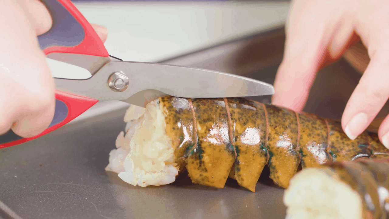 Cutting Lobster Tails with scissors.